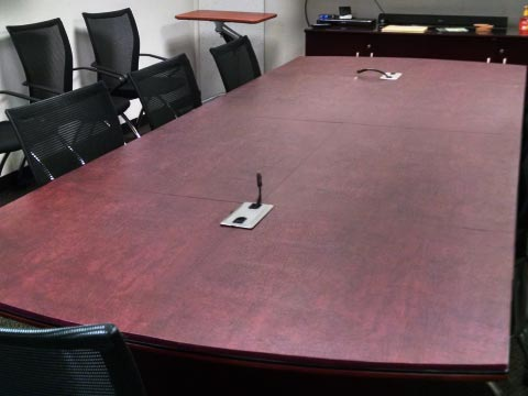 Conference room table pad with cutouts for microphones
