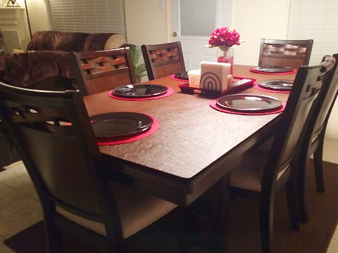 Protective dining table pad with plates and centerpiece