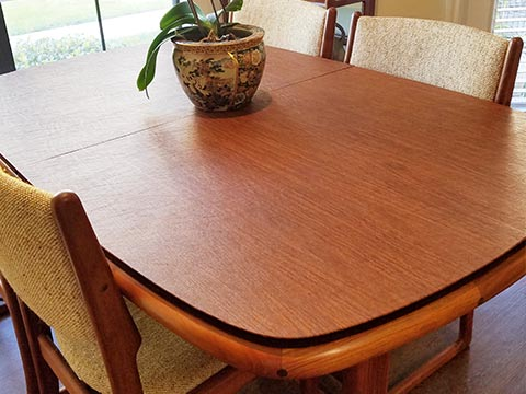 Round-sided rectangular cherry wood dining table protector pad