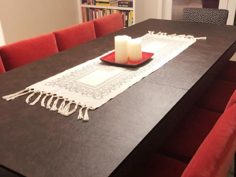 Long rectangular dining table with protector pad