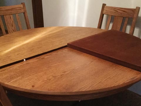 Round dining table protector with folding sections