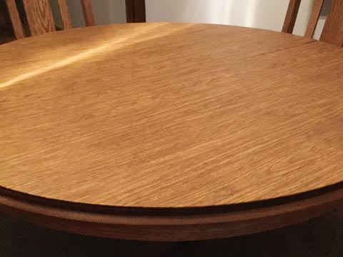 Circular dining room table protector pad photo