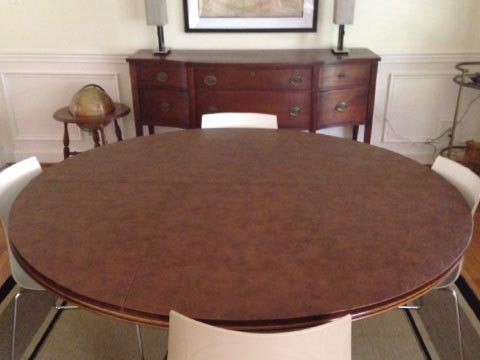 Circular leather-look dining table protector pad