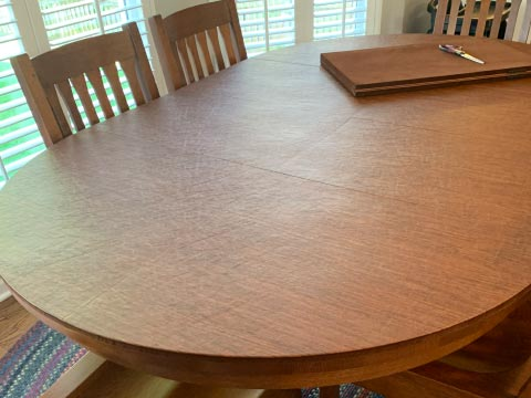 Oval dining table protector pad, in oak woodgrain