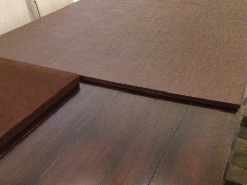 Rectangular table pad photo with section folded for storage
