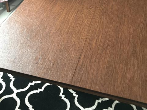 Light cherry wood dining table protector pad