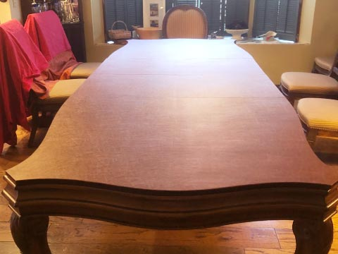 Custom shaped table protector with custom scalloped edges and corners