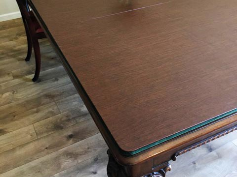 Dining table pad with small round corners