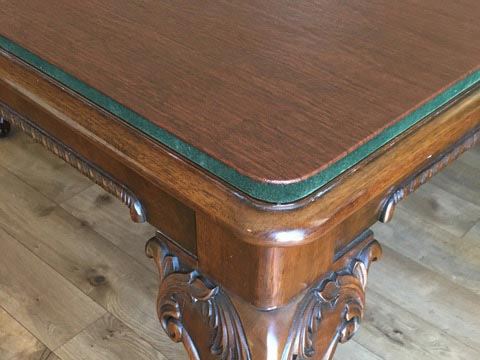 Dining table pad round corner close-up with green velour bottom