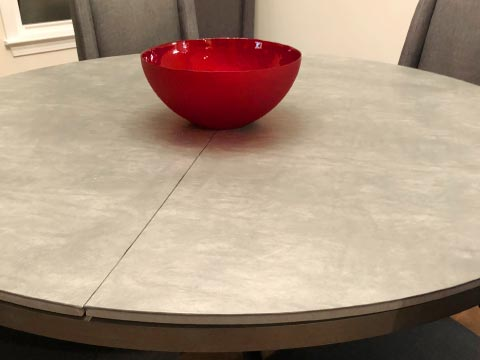 Gray leatherlook round table protector pad