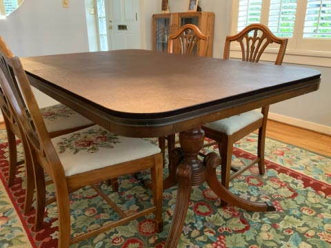 Rectangular dining table protector pad with round corners