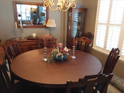 Round dining table protector pad under centerpiece