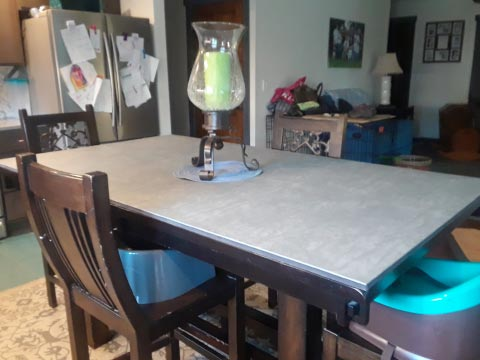 Rectangular table pad protecting surface from centerpiece