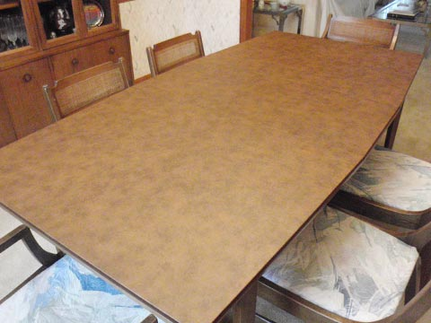 Tapering dining room table protector photo