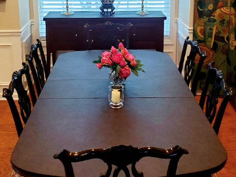 Round-ended dining table protector pad with matching buffet/sideboard