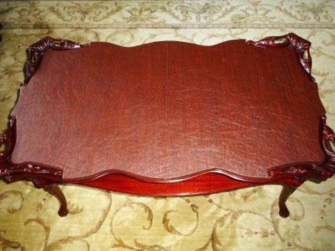Custom-shaped coffee table protector photo with scalloped edges