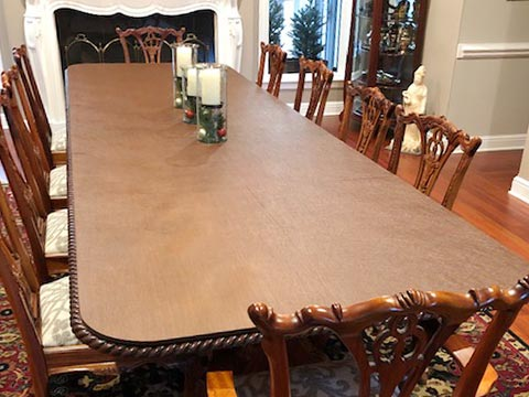 Protector for dining room table with carved edge