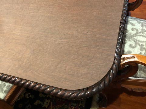 Close-up of rounded corner on protector for table with carved edge