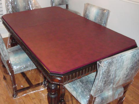 Custom table protector pad with truncated corners, in mahogany leatherlook