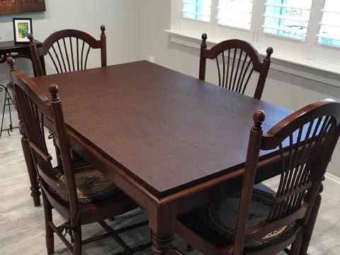 Dark cherry wood rectangle dining table protector pad