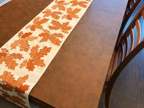 Leather-look dining table protector pad