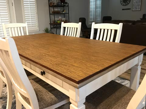 Sharp-cornered rectangle dining table with oak woodgrain protective pad