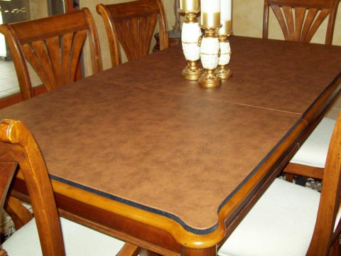 Table protector pad with custom shaped corners