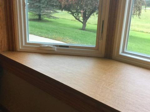Box window ledge protected by removable pad