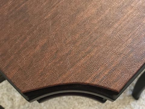 Close-up of table pad with concave corners