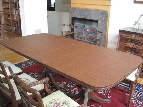 Dining table protector pad with rounded ends, in cherry woodgrain