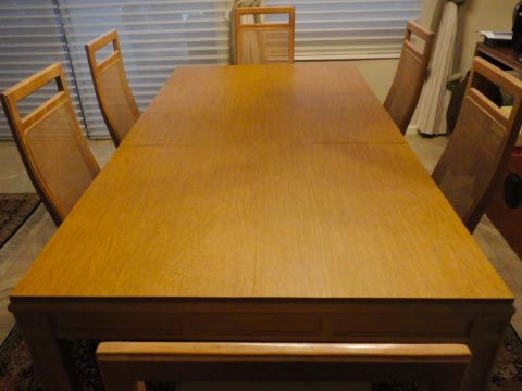 Dining room table protector pad in light oak woodgrain